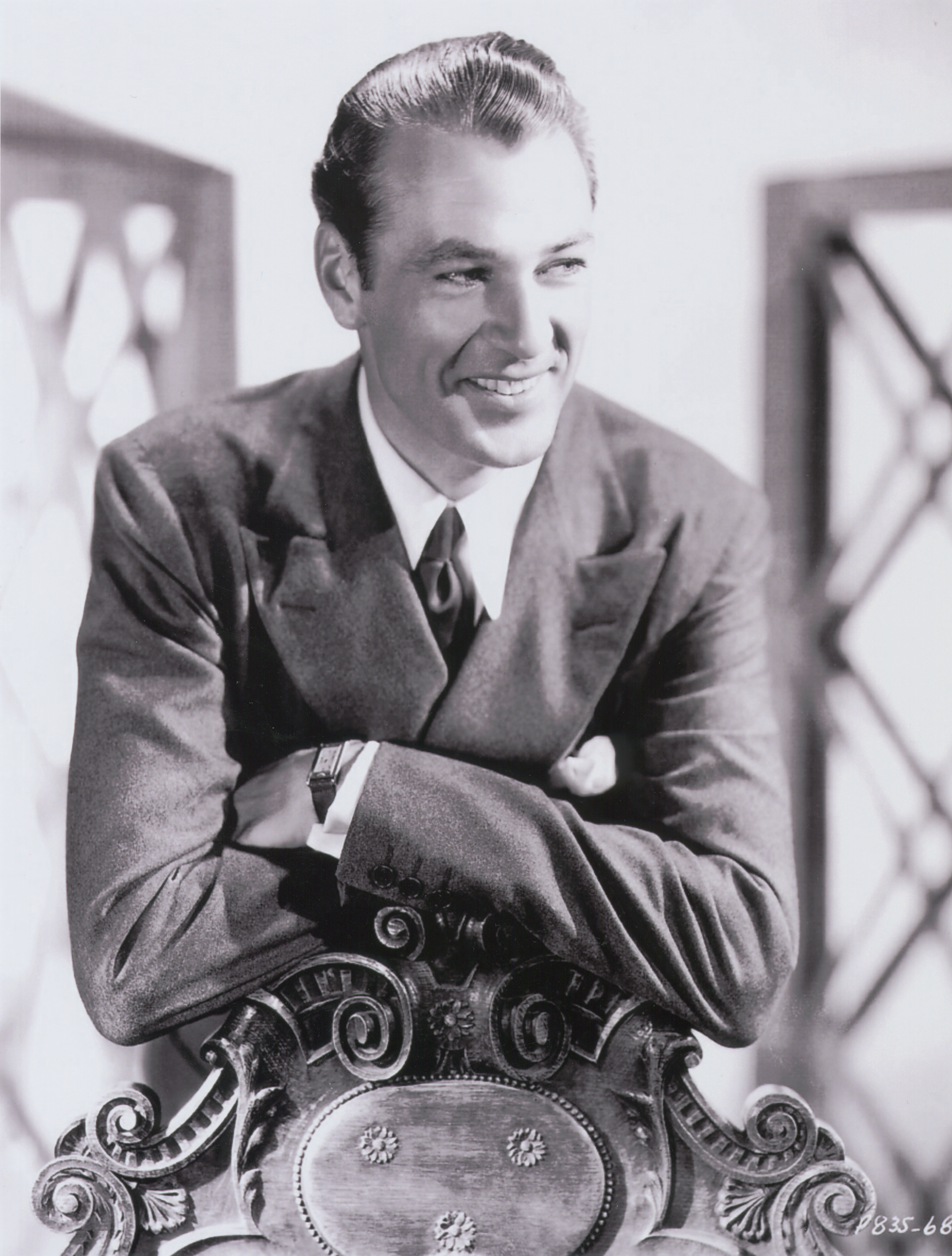 American actor, Gary Cooper wearing his Tank Basculante watch