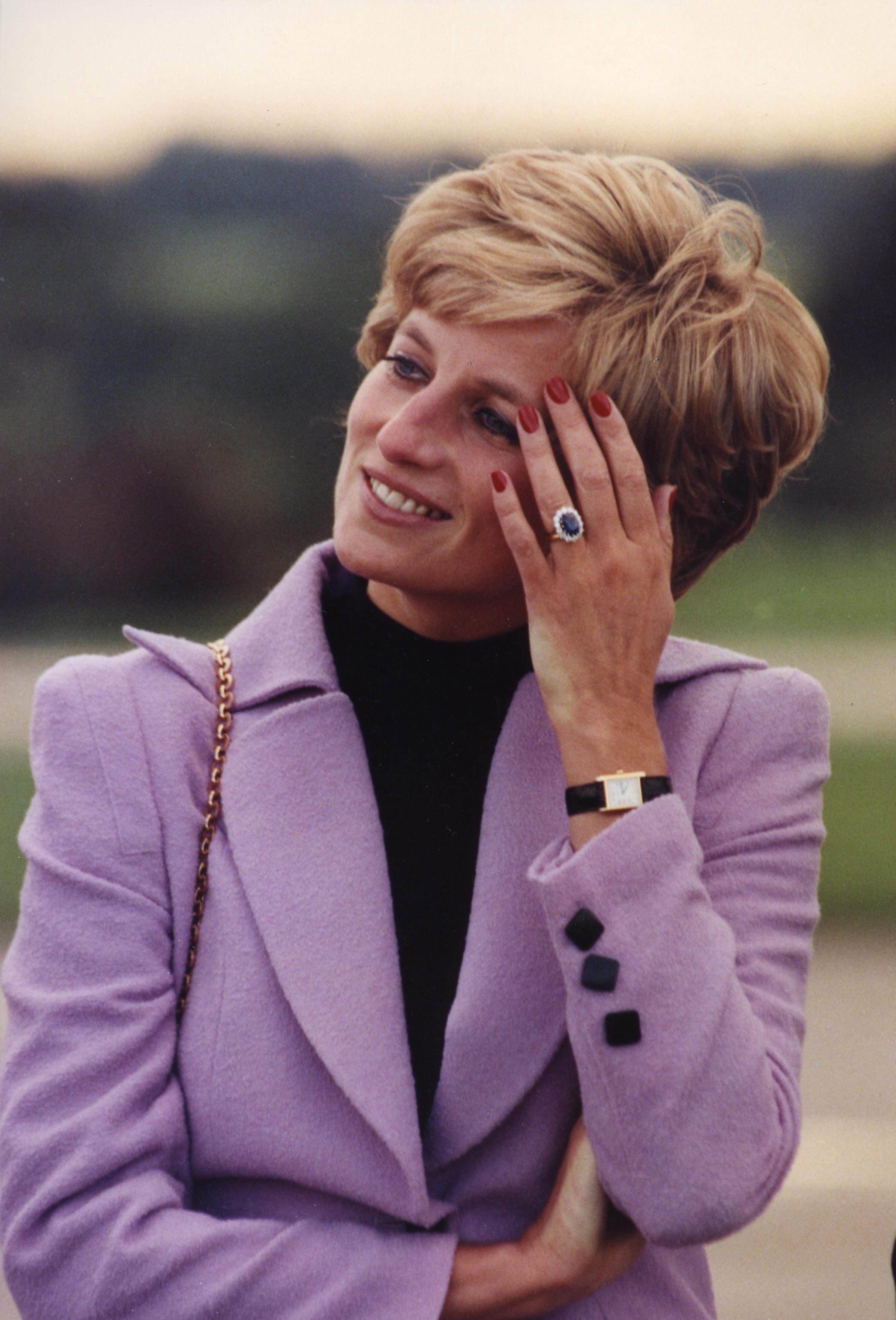 Lady Diana wearing her Tank watch.